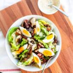 Make this classic chicken caesar salad with some egg and anchovies. Great to serve for lunch or dinner and really easy to make. Visit fastfoodbistro.com for the full recipe #fastfoodbistro #salad #caesarsalad #caesarsaladrecipe #dinner #lunch