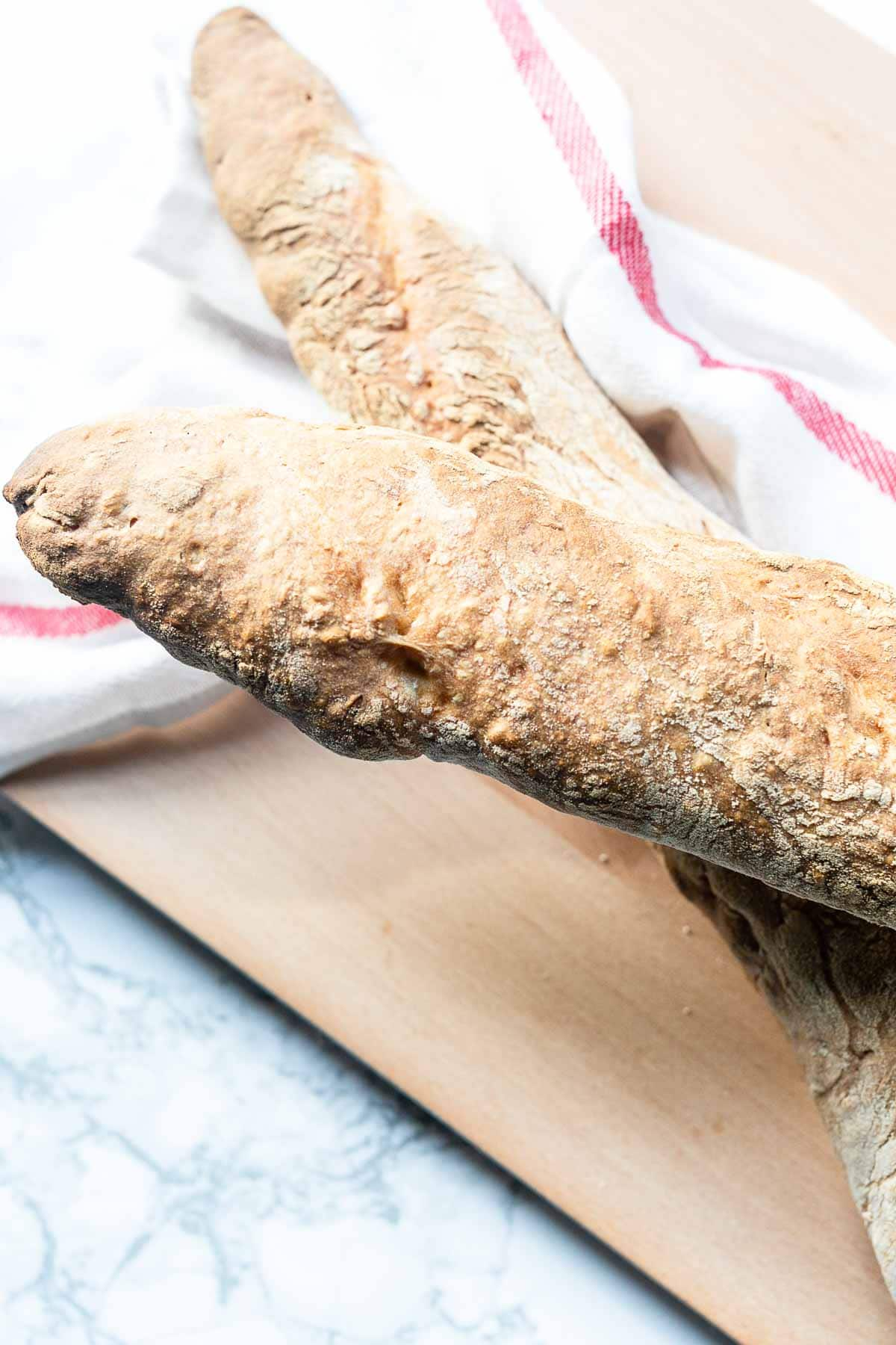Looking for a homemade crusty French baguette? Take a look at the French baguette recipe. A handful of ingredients and easy to make. Visit fastfoodbistro.com for the full recipe. #fastfoodbistro #frenchbaguette #baguette #frenchbaguetterecipe #bread #breadrecipe