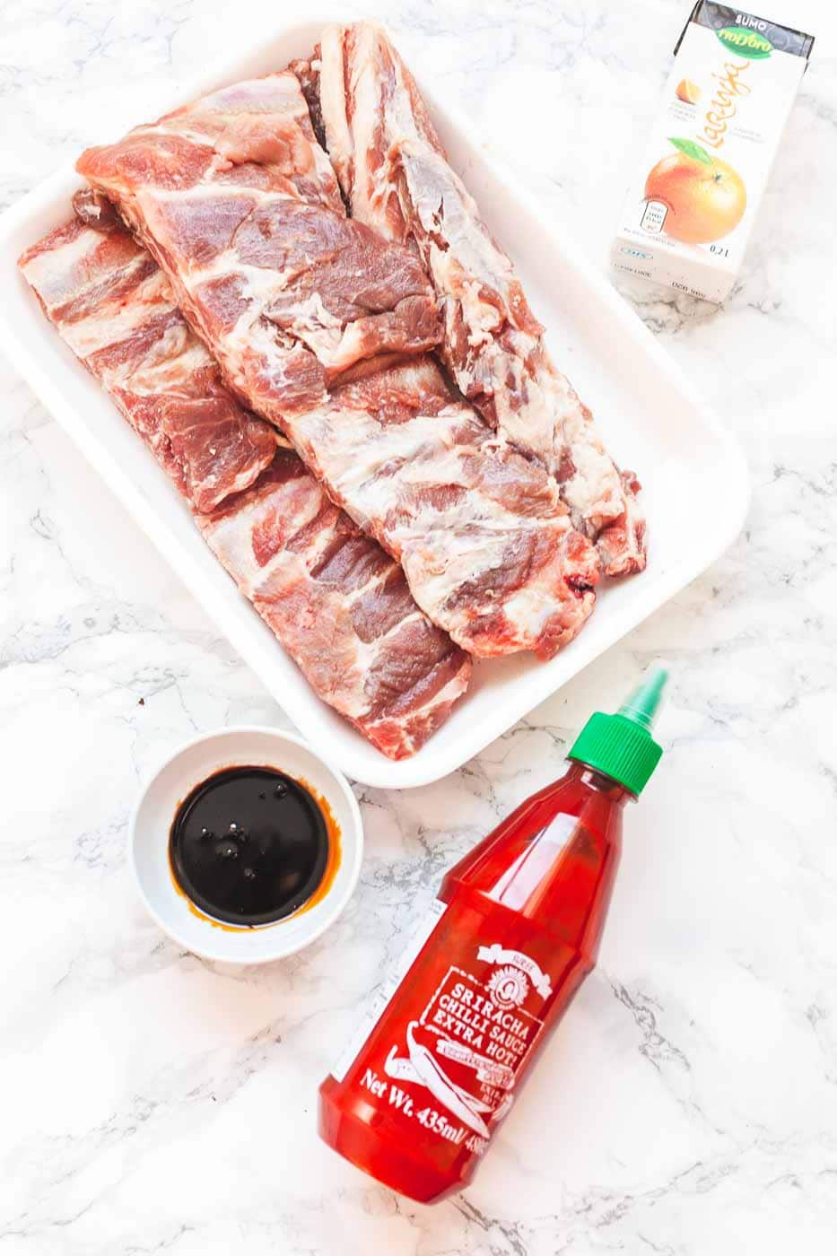 Looking for simple and quick grilled spare ribs? Try this barbecue pork ribs recipe and you have BBQ ribs on the table in a little over an hour. Visit fastfoodbistro.com for the full recipe #fastfoodbistro #grilledspareribs #grilledporkribs #bbqporkribs #howtogrillribs #howtogrillspareribs #sweetsoyribs