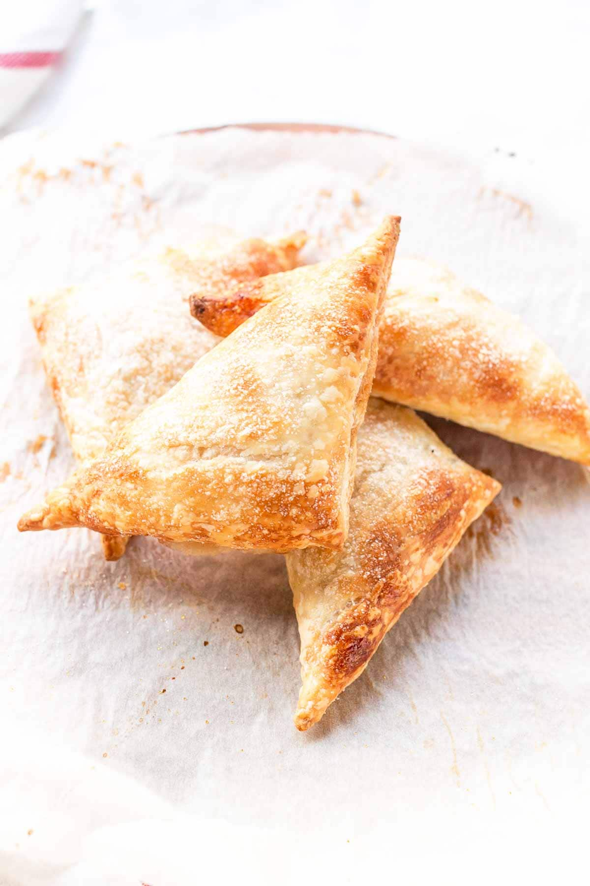 Looking for a sweet pastry dessert? Try these puff pastry apple turnovers. Made with homemade apple pie filling and done in less than 30 minutes. Visit fastfoodbistro.com for the full recipe #fastfoodbistro #appleturnovers #puffpastryappleturnovers #dessert