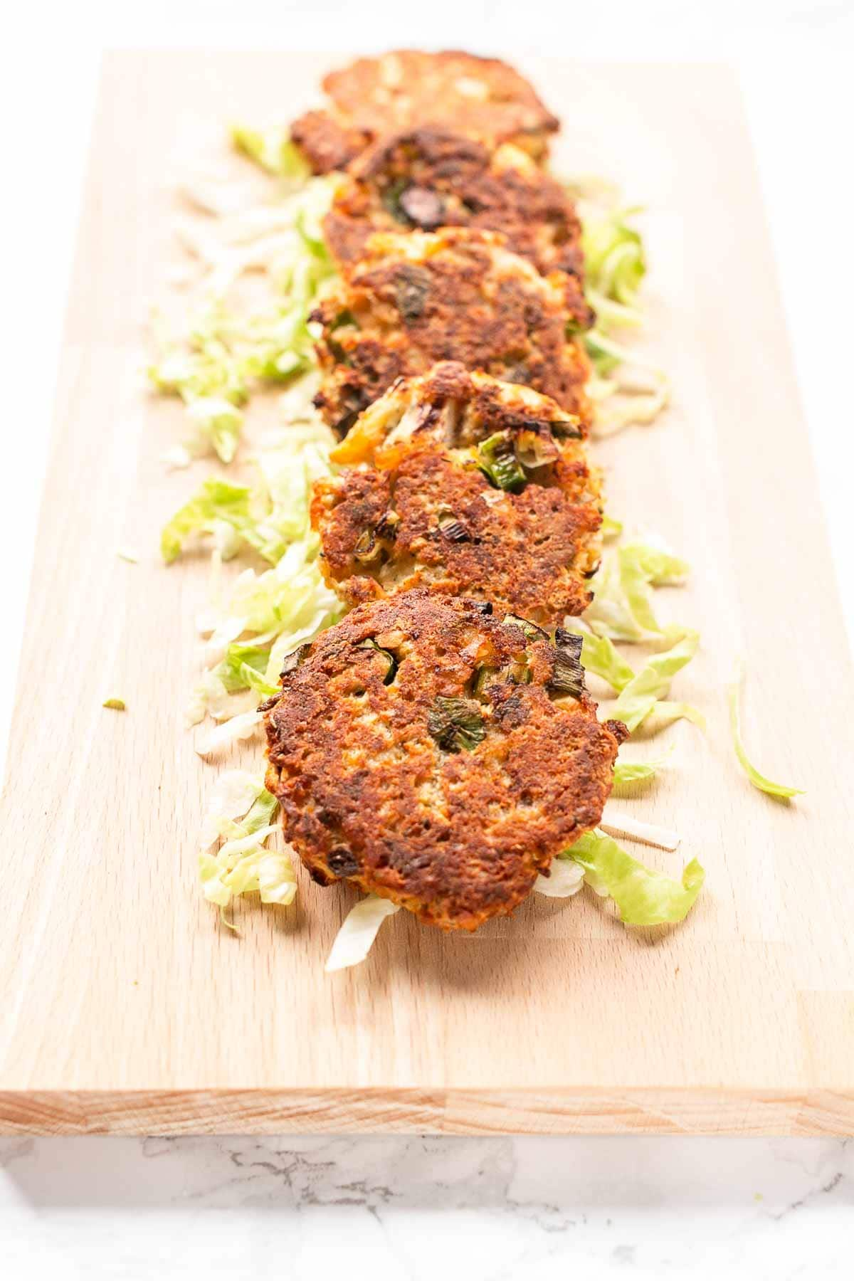 These canned salmon cakes are amazing. Serve hot or cold, with a dip. You can easily serve these with a full meal as well or big sized as a burger! Visit fastfoodbistro.com for the full recipe #fastfoodbistro #appetizer #salmoncakes #salmonpatties #salmoncakepatties #cannedsalmon